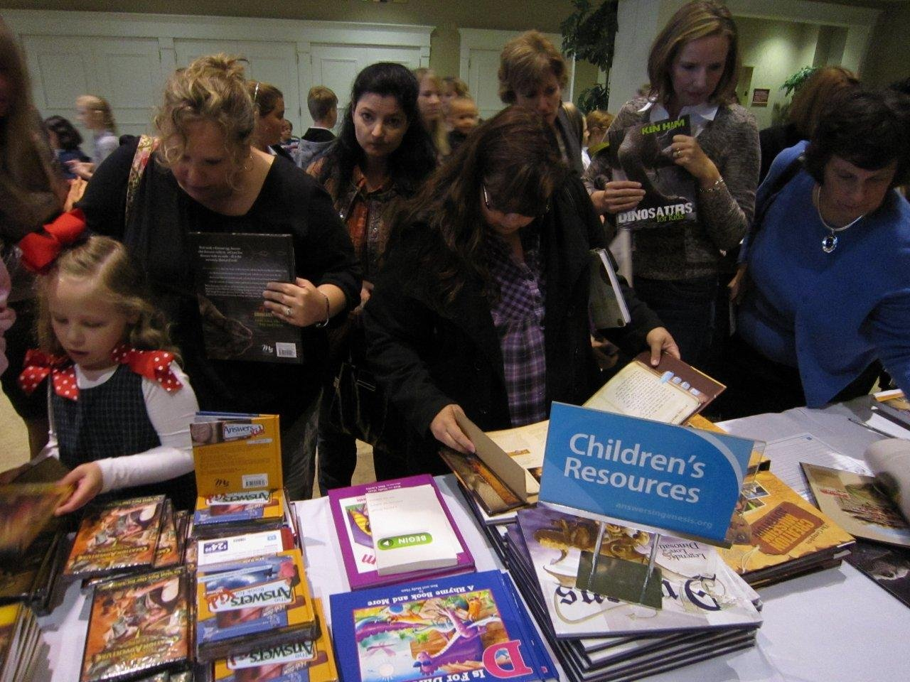 Kids and parents at the resource table