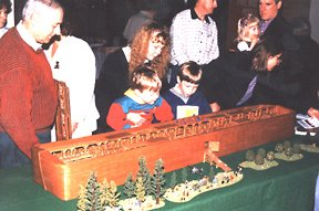 Model of Noahs Ark, with trees and animals to scale, with fascinated onlookers