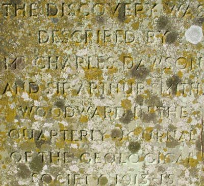 Bottom of monument inscription.