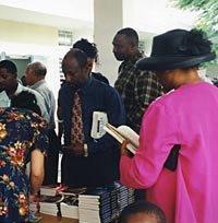 A church group looking at AiG materials