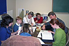 Students and parents studying Genesis