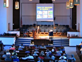 Dr. Mitchell speaking to First Baptist Church