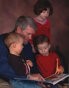 Ken reading to his grandchildren.