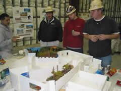 Construction crew looking at museum model