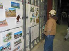 Crew member looking at exhibit descriptions