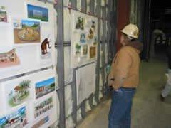 Crew member looking at exhibit descriptions