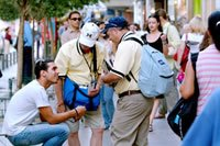 Two men pass out gospel materials in downtown Athens at the 2004 Games in Greece