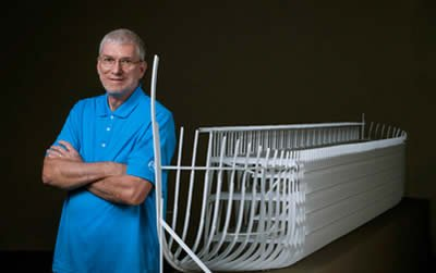 Ken Ham next to Ark model