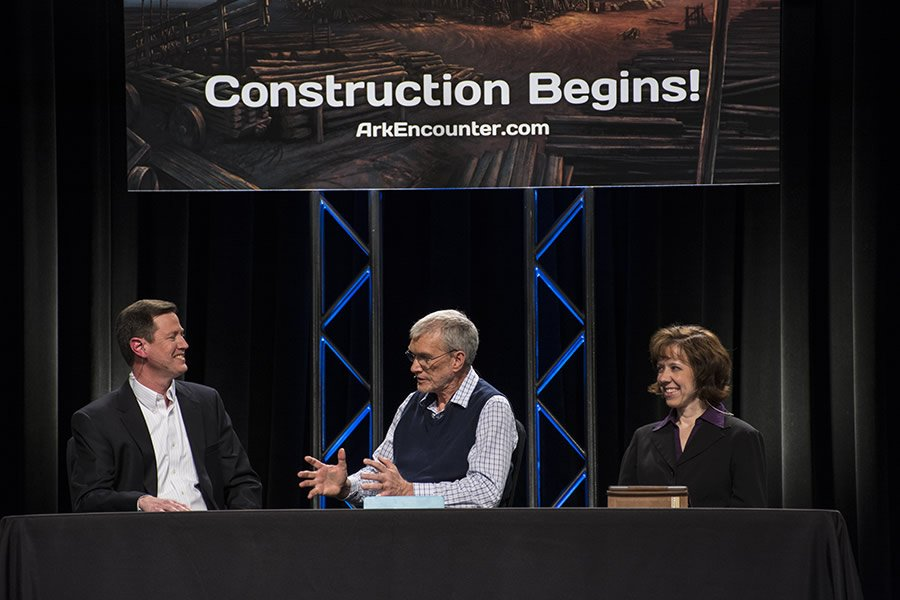Ken Ham is flanked by Joe Boone and Dr. Georgia Purdom as they announced the successful closing of the Ark bond.