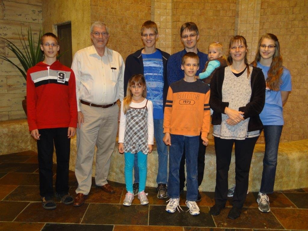 A photo of the Romeike family with Ken Ham inside the Creation Museum.