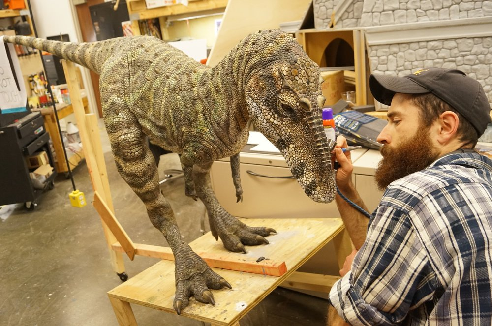 Joel Briggs Painting a Dinosaur