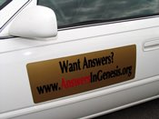 Answers in Genesis advertisement on a car door