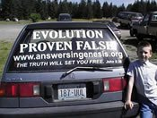 Answers in Genesis advertisement on a rear window