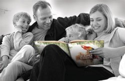 A family reads the Answers in Genesis Zoo Guide