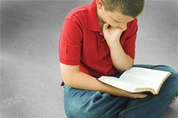 Child reading his Bible.