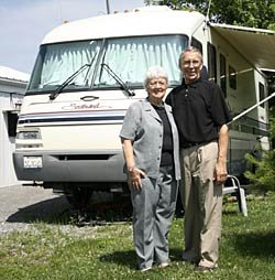 Bob and Jan Thompson with motor home