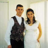 New Zealand Caucasian husband and Malaysian-Chinese wife on their wedding day