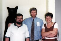 Ken Ham with Sergei, Olga and a mounted bear—a symbol of the former Soviet empire