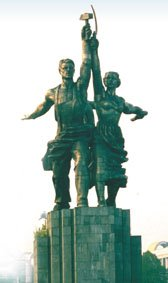 Statue of Soviet male worker with hammer and female collective farmer with sickle, Moscow