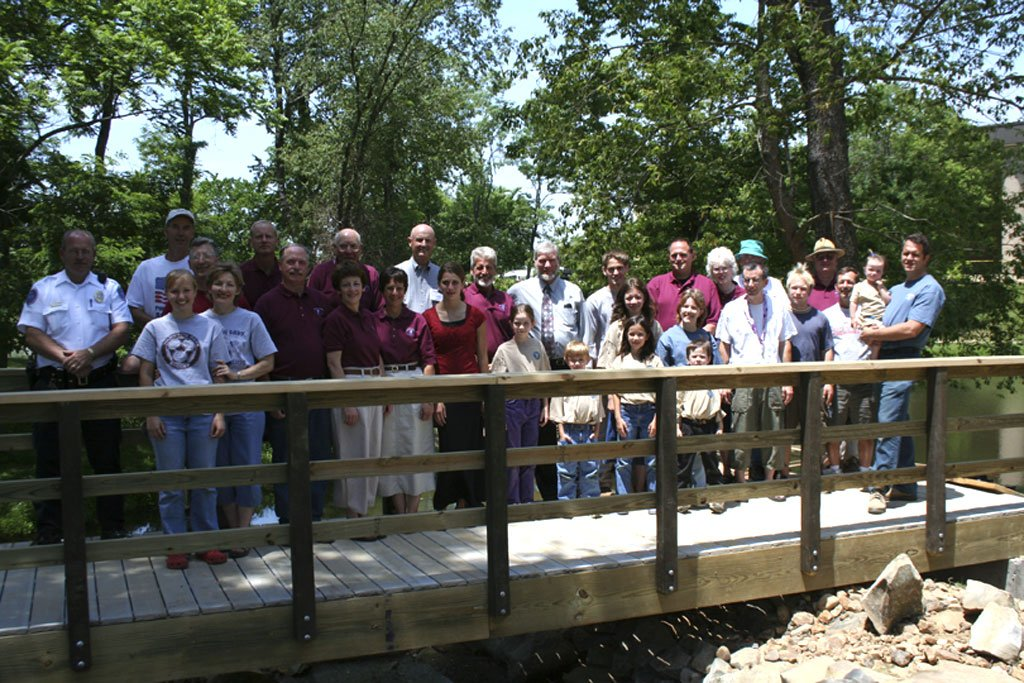 Group standing on bridge