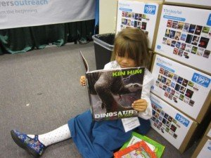 Girl Reading Dinosaurs for Kids