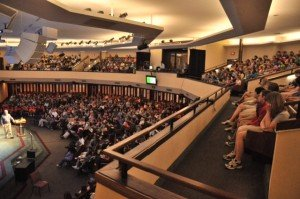 Children packed to overflowing in the auditorium