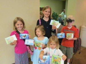 Children with Dinosaur cards