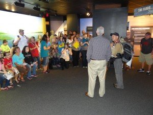 "Because Lowell started his trip at the bottom of the Grand Canyon four months ago, it was appropriate that his 1,800 walk ended at the ""Grand Canyon and Flood"" exhibit inside the museum. Here I am welcoming him, in front of Lowell's family and friends."