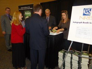 "Signing copies of my ""Six Days"" book at the Expo Hall yesterday."