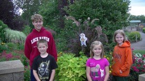 """Flat Ken hanging with the kids in the beautiful gardens at The Creation Museum"""