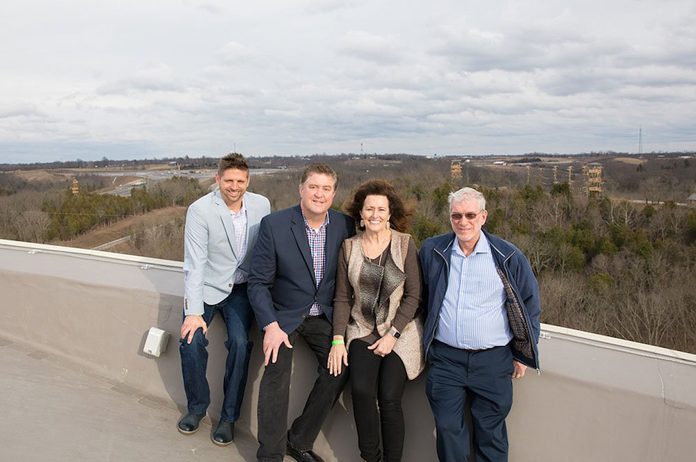 Steve and Donna Gaines on Roof with Ken Ham and Corey Abney