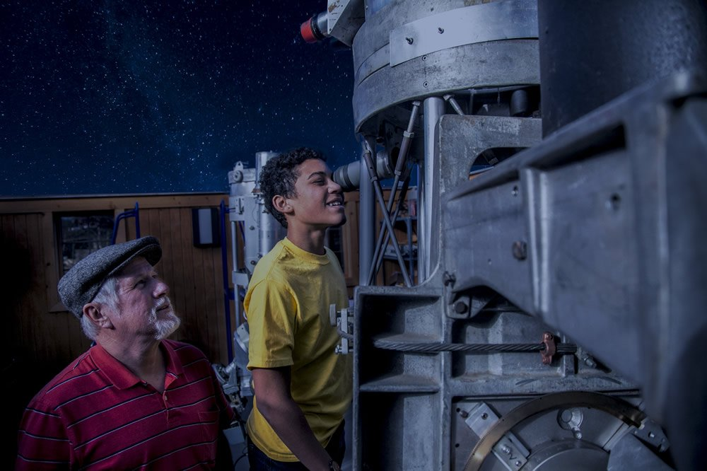 Looking through a telescope at the Creation Museum