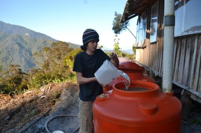 Kian filling water tanks