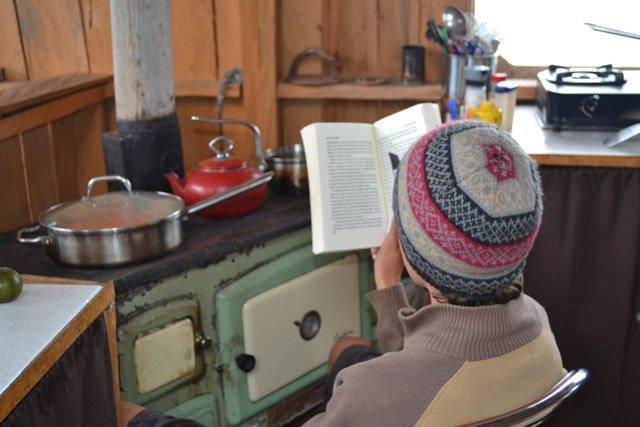 Hudson at wood stove