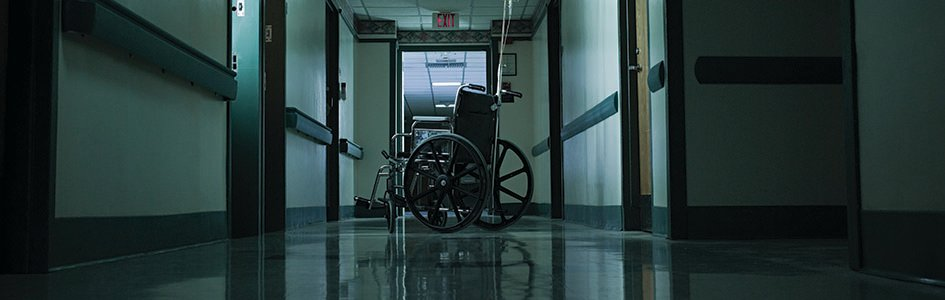 Wheelchair in Empty Hallway