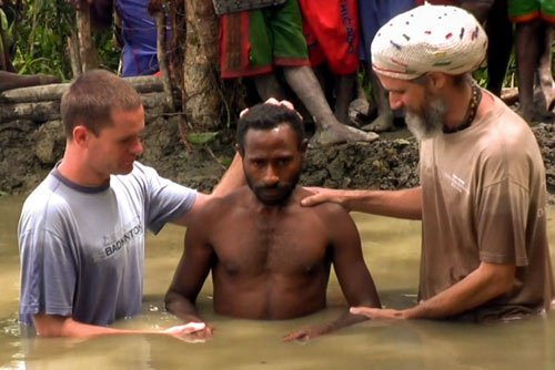 Tribal man being baptised